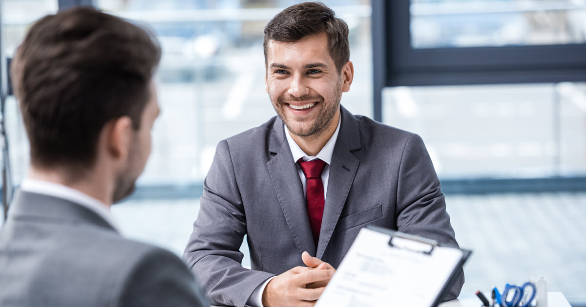 Man applying for a job as an insurance broker in Australia.